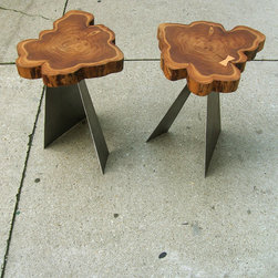 "Cross-cuts - This pair of teak side tables offer a unique visual addition to a living environment. The tops are cross-cuts from teak trees a the bases are constructed out of 1/16"" thick mild steel plate. I hand cut and fit the oak bowtie at the split and finished the tops with oil."
