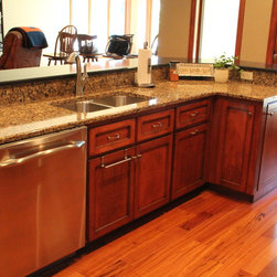 Kitchen cabinetry using maple wood -