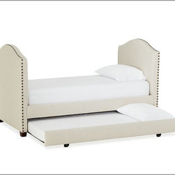 Raleigh Upholstered Daybed with Trundle - A daybed is a great option if your guest room doubles as an office. This one even has a trundle to sleep more than one guest. Line the back with pillows for lounging.