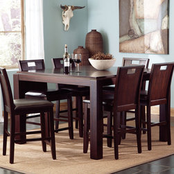 Coaster - Prewitt Counter Height Table - Bring bold contemporary style into your home with the Prewitt dining collection. A rich dark espresso finish and sturdy block legs create a bold look. An extension leaf expands this table to 56 inches square so you can accommodate a group for dinner and drinks. The side chairs feature unique wooden chair backs with cutouts for a distinctive touch, while dark brown vinyl upholstered seats add comfort and durability.