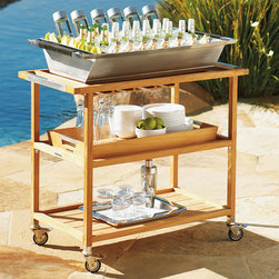 Frontgate - Large Teak Tray - Crafted of solid teak with weather-resistant stainless steel accents. All surfaces are smoothly sanded. Dual handles for easy mobility. Stainless steel casters provide mobility. Casters lock for safe operation. Solid Teak Bar Cart and Accessories are designed for all-weather, chair side service. The serving cart is a handsome, organized way to keep drinks, snacks, and utensils close at hand. .  . . . .