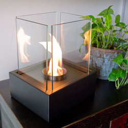 """Bluworld Nu-Flame - Lampada Personal Tabletop Ethanol Fireplace - """"Lampada"""", Italian for lamp light, is one of our newest tabletop fireplaces. Lampada is the perfect centerpiece or gathering point for friends and family. A beautiful way to add luxury and warmth making it the perfect gift to give or receive!The colorful flames stand out against the classic black body and safely behind the tempered glass windscreen... beautiful and functional. This open ultra modern design allows the beauty and colors of the flames to be enjoyed by everyone. Relax and unwind as you watch the fascinating flames. Ships with snuffer tool. Perfect for any setting. Lampada tabletop bio-fireplace may be used indoors or out, however do not leave your fireplace outside exposed to the elements after use."""