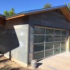 Munro Realty - Modern aluminum frame glass garage door with obscure glass