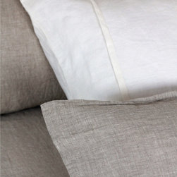 Pom Pom at Home Louwie - Cert. Organic - Flax - King Sham - Decorative flange seams offer modest decoration and a tailored effect to the suave, solid flax linen of the Louwie sham.  Entirely woven from certified organic linen fibers, this simple sham is the perfect host to jewel-toned throw pillows but looks sleek and comforting with other neutral tints as well.  Whatever the wall color in your bedroom, the Louwie Sham will improve it with a complementary warmth and the unmistakable texture of soft linen fabric.
