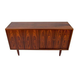 Used Danish Modern Rosewood Sideboard Media Cabinet - An excellent Danish Modern rosewood cabinet with a high luster & stunning grain! By Hundevad, Denmark, this compact sideboard features 2 adjustable shelves & one felt lined drawer. It is the perfect candidate to house your media components. The piece is accented with nice tapered legs.