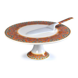 """Concepts Life - Concepts Life Cake Stand and Server  Exotic Taste Collection - Add some exotic flare to your celebration with our Exotic Taste Collection. This fine porcelain cake stand is an eye-catching centerpiece, perfect for dessert or a savory quiche (we'll have a slice, thank you). Comes with matching porcelain server.  Timeless white porcelain - perfect for any occasion Great for desserts and appetizers Durable and stain resistant Care: Dishwasher and freezer safe Material: 100% Porcelain Dimensions: 12"""" in diameter and 5""""h"""