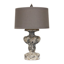 Italian Urn Lamp - The look of a heavily antiqued, artistically damaged finish brings a potent aura of history to your room. The Italian Urn Lamp adds this artistic effect as well as useful illumination with a dark stone base inspired by the designs of the 17th century. Details such as dramatic fluting and a floral scalloping vessel just below the rim of the taupe linen drum shade show beautifully through the pale wear in the traditional lamp base and its matching finial.