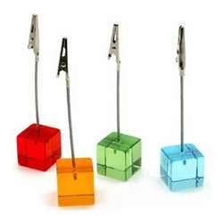 MoMA - Cube Clips - A modern accessory that stylishly displays your postcards, photographs, or place cards. The card holders consist of an acrylic base which support the vertical metal clip. The set of four includes the colors shown.