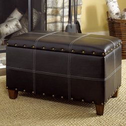 "Hammary - Hidden Treasures Trunk Cocktail in Black - Hammary's Hidden Treasures collection is a fine assortment of unique accent pieces inspired by some of the greatest designs the world over. Each selection is rich in Old World icons and traditions. Every piece in this collection is crafted with the upmost attention to fine details. Each item is a work of art from brass nailhead trim and exquisite hand-painting to elegant shaping and decorative trim. Wide varieties of materials are used to create a perfect look and fine quality which includes exotic woods, leather, and stone to raffia and glass. The wide variety of finishes, hardware, beautiful carvings and other final touches offer unmatched versatility for any room in your home. Hidden Treasures features cocktail tables, occasional and accent pieces, trunks, chests, consoles, wine racks, desks, entertainment units and interesting storage pieces. Place one in a comfortable reading nook. . . in the family room for flair and variety. . . in the foyer for a welcome look. . . in a bedroom for a cozy style. . . or in the office for function and versatility. The pieces in this collection mix beautifully with any decorating style and will easily become the focal point in any setting.; Hidden Treasures Collection; Finish:; Stitched PVC (Faux Leather); Stop Hinge Lid; Antiqued Brass Nail Head Trim; Brown Fabric Lining on Inside; Inside Dimensions: W27 1/2 D14 1/2 H11 1/2; Weight: 24 lbs.; Dimensions: 29. 5""W x 16. 5""D x 18""H"