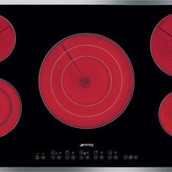 "Smeg - S2951CXU 36"" Smoothtop Electric Cooktop with 5 High-Light Radiant Elements Inclu - The Smeg ceramic cooktop angled-edge glass with 5 high-light radiant elements including 2 variable zones has pristine characteristics that combines style and high technology The 9 power levels for each zone offers a spectrum of heat power that can ac..."