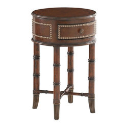 Lexington - Tommy Bahama Home Landara Bandera Leather Accent Table - Burnished Maple and dark Cherry inlay top with a quartered Rosewood boarder compliment the sophisticated design of this piece, with leather strapped carved rattan to compliment the metal accents and ferrules finished in an antiqued brass patina. Four curved panels with leather and nail head trim, one of which serves at a box drawer.