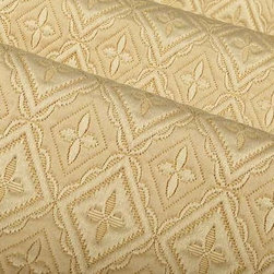 Rebecca Italian Upholstery Fabric in Sand - Rebecca Italian Upholstery Fabric in Sand has a quilted traditional geometric pattern with a feminine feel and neutral color. his fabric has a soft texture that creates a cozy feel perfect for upholstering sofas and chairs, or for creating custom bedding. Made in Italy from a blend of 26% cotton, 22% viscose, and 52% polyester. Width: 54″; Repeat: 2 3/4″H; 3 1/4″V