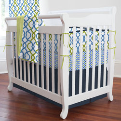 "Navy Waves Mini Crib Bedding - Making waves will never be easier or more fun than with this must-have bedding collection. Your little man will delight in the fun geometric patterns and shapes of our Make Waves fabric. Classic colors of navy and citron enhance this ensemble opening it up for a world of decor ideas for your nursery and beyond. Perfect for smaller nurseries or for staying at Grandma's, portable mini-cribs are a great space-saving alternative to standard sized cribs. Our mini-crib bedding is designed to fit portable cribs using mattresses measuring approximately 24"" x 38""."