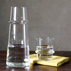 Ramos Carafe and Cup - Made of strong, light-weight borosilicate glass, the Ramos Carafe and Cup feel wonderful to hold-lightweight but substantial and firm. Perfectly suited for a bedside water vessel for your master suite or guest bedroom, the Ramos is useable and refined.