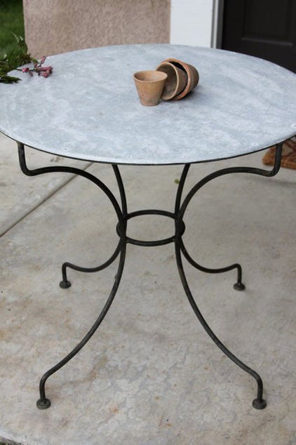 traditional outdoor tables by Greige