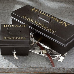 "Bryant Storage Compact, Small - Styled to look like a bank box, this toolbox-sized men's jewelry box is lined with linen on the inside and closes with a lock and key. Square: 6.5"" square, 4.25"" high Rectangular: 16"" wide x 6"" deep x 4.25"" high Made of iron. Holds a tray made of MDF and lined with linen. Handle on top. Screen-printed text."