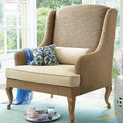 Alsace Rope Wingback Chair - Our updated take on the traditional wingback chair has a cool coastal feel that looks lovely wherever you place it. Natural jute roping is wrapped by hand around a sturdy solid birch frame with carved cabriole legs. The down-wrapped seat cushion and lumbar pillow are beautifully upholstered in heathered cotton flax with welt stitching, adding another rich textural element to this chic and sophisticated chair.