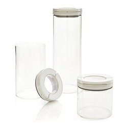 OXO® Glass FlipLock Canisters Set of 3 - Crystal clear food storage canisters in shatter-proof borosilicate glass are outfitted with tight-sealing lids that flip open and closed. Multiple inner locking tabs create airtight, watertight seals; modular containers with view-through lids stack in the pantry or freezer, nest for compact storage.