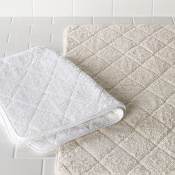 """Matouk - Cairo Quilted Tub Mat - IVORY - MatoukCairo Quilted Tub MatDetailsA plush tub mat in soft tones.Choose (shown left to right) white or ivory.Tonal piping.625-gram ring-spun Egyptian cotton terry.36""""L x 24""""W.Machine wash.Made in USA.Designer About Matouk:The son of a jeweler John Matouk understood the principles of fine workmanship and quality materials. After studying fine fabrics in Italy he founded Matouk in 1929 as a source for fine bed and bath linens. Today the third generation of the Matouk family guides the company whose headquarters were relocated to the United States from Europe during World War II. Matouk linens are prized worldwide for their uncompromising quality and hand-finished detailing by skilled craftsmen."""