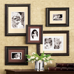 """Exposures - Thames Wall Picture Frame Set - Overview We've mixed three distinctive solid wood frames to create this eclectic picture frame set. All hanging photo frames are handcrafted, with high-contrast double mat included. Features More than $70.00 in savings! Includes 3 different solid wood frame styles Double acid free mats included Vertical or Horizontal Wall display only Various frame sizes included  Thames Wall COLLECTION AS SHOWN INCLUDES: Props are not included. Two 300769 - Battersea 4 x 6 (One each with Chocolate & Tan Mats) One 300768 - Chelsea Double 5 x 7 One 300767 - Chelsea Single 8 x 10 One 300765 - Kensington 4 x 6  Specifications  Battersea 4 x 6 frame measures 11 1/4"""" x 13 1/4""""overall Chelsea Double 5 x 7 measures 15"""" x 19"""" overall Chelsea Single 8 x 10 measures 15"""" x 19"""" overall Kensington 4 x 6 measures 9 1/2"""" x 11 1/2"""" overall"""
