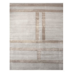 Donghia - Consigned Donghia Silk and Wool Rug - Tones of camel and ivory reveal a subtle pattern in this area rug by Donghia. Measuring at 22 feet x 15 feet, it's ideal for adding plush texture to larger rooms and loft spaces. In like new condition. Manufactured in USA, 2014.