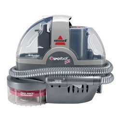 """Bissell® Titanium SpotBot® Pet - Let's say your pup has a bit of an """"excitability"""" problem, especially when new guests arrive. No need to drop to your knees and clean just as you're welcoming them in. Sic this cleaner on the carpet and it does the work itself. My friend uses this all the time, unfortunately, and it's quiet, but powerful enough to knock out messes without disturbing your get-together."""