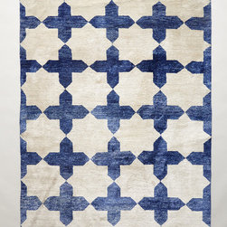 Checkered Stars Rug - A rich array of sapphire hues and sumptuous texture, this geometric design is inspired by centuries-old architecture in Salamanca, Spain. It's hand-knotted from a luxurious blend of silk and bamboo yarns that gleam in the light.