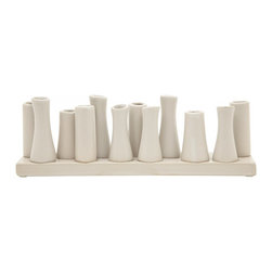 Ceramic 12-bud Vase - I love this 12-bud vase. It would look so beautiful as a centerpiece for an outdoor garden party with different colored stems in it.