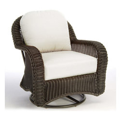 Frontgate - Classic Wicker Swivel Outdoor Glider Outdoor Lounge Chair with Cushions, Patio F - Ideal for any environment, including oceanfront and saltwater destinations. Seat and back are hand-woven from high-quality resin, an exceptionally durable all-weather material that is specially formulated to resist fading. Hand-welded aluminum alloy frame is finished with a durable baked-on polyester powder coating to protect against the elements. Diamond-back weave design, sturdy braided frame, and ball feet with permanent nylon foot glides. Cushions feature exclusive solution-dyed fabrics, created using only the finest materials and technology for longevity outdoors, including Sunbrella&reg. The Classic Wicker Swivel Lounge Chair by Summer Classics&reg offers the vintage look of traditinoal wicker, updated with the durability of all-weather high-quality resin wicker materials. This swivel lounge chair is a perfect addition to any outdoor setting including beach and salt water environments. Frame is generously proportioned to accomodate the included plush, all-weather cushions. Choose from an assortment of high performance outdoor fabrics, including Sunbrella&reg for year-round enjoyment.Part of the Classic Wicker by Summer Classics&reg Collection. . . . . . Black Walnut or Weathered Pebble finish . Note: Due to the custom-made nature of the cushions, any fabric changes or cancellations made to the Classic Wicker Collection by Summer Classics&reg must be made within 24 hours of ordering.