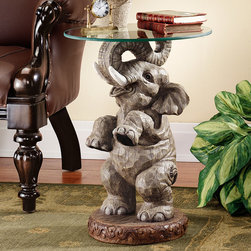 Design Toscano - Good Fortune Elephant End Table - His trunk raised to symbolize good luck, our pint-sized pachyderm lends a touch of the exotic while deftly balancing a 0.375'' thick, 16-inch dia., pencil-edged glass tabletop. Realistically hand-painted, our scaled Toscano exclusive lends a sense of adventure to any well-appointed room. Features: -Hand painted.-Design Toscano exclusive.-Quality designer resin construction.-Distressed: No.Dimensions: -Overall Product Weight: 18lbs.