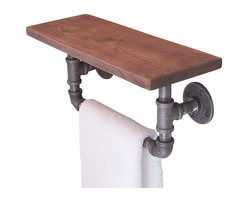 Industrial Pipe Hand Towel Shelf - Crafted of pine wood and rugged black steel pipes. The black steel pipes are brushed down to bare metal and sealed with a clear coat lacquer while the pine wood shelf is distressed by hand to give it a time worn appearance. It has visible marks and indentations. Sealed with a finishing wax to protect the wood without concealing its character.