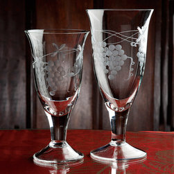 Frontgate - Set of Six Harvest Purples Water Glasses - 16 oz. capacity. Dishwasher safe. Since each piece is handmade, no two are exactly alike. Elegant mouth-blown artisanship and fine engraving make our Set of Six Harvest Grapes Water Glasses worthy of your finest occasions. The decorative grapes design makes these crystal-clear vessels a perfect pairing for our Harvest Grapes Wine Glasses. .  .  . Imported.