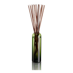 DayNa Decker Botanika Essence Diffuser 16 oz - Posy - The Essence Diffuser is a streamlined new take on a home fragrance solution that is elegant in its simplicity. Best-quality botanical oils expertly blended into intense multi-noted mixtures fill bottles hand-blown from recyclable glass into polished round shapes with smoothly curved, narrowing mouths. When the 20-24 sticks of sustainable wood are allowed to rest in the oil, they draw the fragrance notes up from the bottle and release their pleasurable aromas into the air.