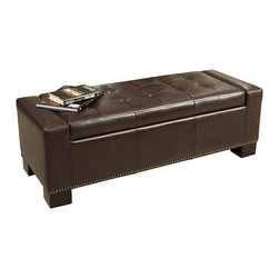 Great Deal Furniture - Jaxson Brown Leather Storage Ottoman w/ Studded Accent - The Jaxson Storage Ottoman offers a sleek storage solution for any room in your home. The top easily props up to reveal a spacious interior for pillows, blankets, books, and more. The tufted design on the top of the ottoman provides padding for comfortable seating and the studded accent at the base, adds an extra touch. Use this ottoman as a coffee table, storage unit or for additional seating.