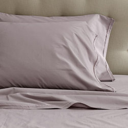 Organic Cotton Frayed-Edge Sheet Set, Light Amethyst - I just may have to purchase these sheets to pair with my navy upholstered headboard. I like that they are organic cotton and have frayed edges.