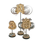 Salvatecture Studio - Vintage Brass Clock Mechanisms on Stands, Set of 3 - Upon close inspection, this trio of vintage mechanisms reveals a world of windings and intricate gears. Step back and you'll see that everything comes together artfully. Each unique mechanism is mounted on a reclaimed gear stand and will work like clockwork in your home or office setting.