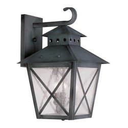 """Livex Lighting - Livex Lighting 2672 Montgomery Large 17.25 Inch Tall Outdoor Wall Sconce - Livex Lighting 2672 Montgomery Three Light Outdoor Wall SconceFeaturing a prominent workman style design, the Montgomery three light top mount outdoor wall sconce features a simple rustic kerosene lamp design with a perforated chimney, four sided roof, and clear seedy glass with """"x"""" shaped guards. This arts and crafts style light will enhance the look of any outdoor decor.Livex Lighting 2672 Features:"""