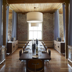 Drape Designers - Grommet Drapes in an Office - Modern grommet drapes section off a loft office to create a wine tasting room