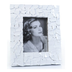 "Concepts Life - Concepts Life Photo Frame  Sacred Mantle  White  5x7"" - Add luxurious shimmer and texture to your most beloved photographs with these Sacred Mantle Photo Frames. These dazzling white frames feature a shell like finish and look stunning when they catch a ray of light.  Modern home accent Contemporary white picture frame Beautiful and elegant home accent Rectangular photo frame Made of polyresin Textured finish Easel back for horizontal or vertical display Various sizes available Holds 5 x 7 in. size photo Dimensions: 9.5""w x 11.5""h x 1""d Weight: 2 lbs"