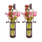 Danya B. - Wall Mount Hanging Glass Cylinder Vase Set with Metal Cradle and Hook - Free up your table space by hanging your flowers aloft, with these rustic metal mounted vase on your wall. This innovative design was expertly crafted from recycled glass and sturdy iron. This set of two wall sconce vases would work well flanking your sideboard, or outside on the patio.
