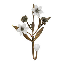 Blooming Branch Hook - Streamline your morning routine by hanging your outfit on a pretty hook the night before. This floral version hung on the back of my bedroom door would make me smile each morning, and it's sturdy enough to handle a heavy coat or suit.