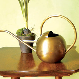 """Achla - 1 Liter Brass Watering Can - This tiny perfect Small Brass Watering Can exemplifies the """"form follows function"""" philosophy and takes it to an even higher level.  Crafted of non-corrosive polished brass, this practical and beautiful Small Watering Can holds and dispenses 1 liter of water.  This beautiful Brass Watering Can holds 1 liter of water and displays a lovely curved & rounded design that's also easy to hold.  The watering can is crafted with care from lustrous brass, renowned for its corrosion resistance and golden tone. * Brass. Holds 1 Liter"""