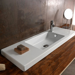 Tecla - Rectangular White Ceramic Wall Mounted, Vessel, or Built-In Sink - Modern style rectangular white ceramic sink with overflow. Sleek bathroom wash basin can be wall mounted, above counter, or vanity. Available with no hole or one hole. Made in Italy by Tecla. Rectangular white ceramic sink. Wall mount, vessel, or vanity. With overflow. ADA compliant. No hole or one hole. From the Tecla Serie 35 Collection. Standard drain size of 1.25 inches. Because the sink has multiple installations, the back side is not glazed.