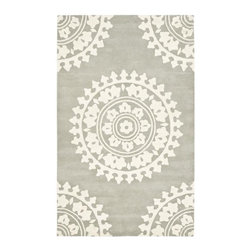 Handmade Soho Chrono Grey/Ivory New Zealand Wool Rug - I really love the medallions on this rug, and the gray hue could work to anchor a nursery and elevate it to make it feel less baby and more plush. This is a rug that is sure to stick around once the room is no longer a nursery.