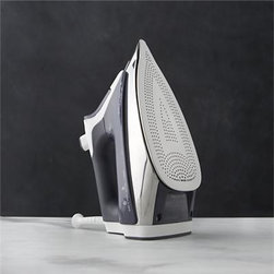Rowenta® Promaster Iron - Self-cleaning iron with anti-scaling system has an extra-large water tank and scratch-resistant plate with 400 microsteam holes for maximum distribution and power bursts for professional wrinkle removal. Ergonomic features include a comfortable, slip-resistant handle and precision tips for tight corners, seams, collars and cuffs.