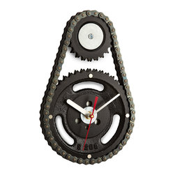 """Inova Team -Modern Reclaimed Car Parts Handmade Wall Clock - Make good time with an industrial clock repurposed from an engine timing gear and chains. What once kept four wheels spinning takes a turn for the interesting--and the artful--with artist Steven Shaver's vision. Inspired by domestic car parts half-buried in junk yards that looked to Shaver like sculpture with a story, he began crafting creatively designed home decor from salvaged gears, chains, and more, for art and conversation. Shaver calls it """"part art."""" We say it's part art, part clock--and all inspiration. Clock features part numbers cast in the metal and industrial details unique to each piece."""