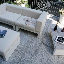 Hour Sofa Pouf and Table by Serralunga - Hour Sofa Pouf and Table by Serralunga. Family of modular sofas for outdoor and indoor areas. The various modules can be combined to create infinite solutions. Ideal for the contract sector. Polyethylene base structure with cushions available in various colours and fabrics. Hour Sofa Pouf and Table by Serralunga are designed by Claudio Bellini.