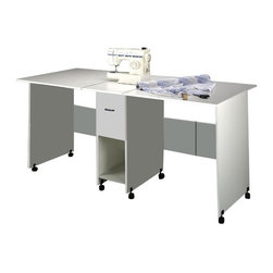 Venture Horizon - Double Drop-Leaf Craft Table w Drawer & Cubby - Extra-large work surface. Ideal working height. Roomy and deep storage drawer. Rugged and sturdy construction. Water and stain resistant. Casters add mobility. Constructed from durable, stain resistant and laminated wood composites that includes MDF. Made in the USA. Minimal assembly required. Weight: 110 lbs.. Table size:. Folded: 19 in. W x 36 in. D x 35 in. H. Assembled: 76 in. W x 36 in. D x 35 in. HMaximum work space for all projects. Ours may be the largest, folding craft table in the world. Fully extended, the surface provides 19 sq. ft of work space. That's practically double that of any standard size desk. Yet, when folded the craft table occupies only 3 sq. ft. of floor space. It's countertop height is great for working while standing up, making it ideal for sewing , quilt making, art projects, model making and more. One deep, oversized drawer plus a spacious shelf provide more than adequate storage for a sewing machine, fabric and other essential materials. Dual track carper casters provide mobility for easy storage.