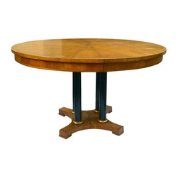 Used Baker Round Walnut Dining Table with 2 Leaves - A rare vintage Baker walnut dining table with a round 50 inch parquetry walnut top. The split, reverse quatrefoil base has four black lacquered columns with gilt detailing. This unique piece will wow your guests! The table includes two 21 inch leaves to accommodate larger groups.     There are some imperfections on the table (see pics).  Also the two leaves vary in color compared to table.     Diameter: 50 inches  Height: 29.5 inches