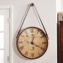 Hanging Decorative 24-in. Wall Clock with Faux Leather Strap - Add a unique rustic touch to any wall with the Hanging Decorative 24-in. Wall Clock with Faux Leather Strap. This clock has an antique appearance thanks to its distressed ivory face and faux leather hanging cord. It has big Roman numerals so you can check the time at a glance and quartz operation to keep it accurate.About BassettBassett Mirror Company Inc. has been one of America's leading names in home fashion since 1922 when the family business was founded on the eastern slopes of the Blue Ridge Mountains of Virginia. Four generations later Bassett still produces beautiful mirrors fine furniture and framed art pieces that are destined to become heirlooms.